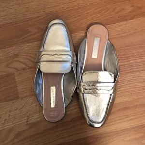 Primary silver slip ons
